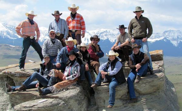 Guests and friends at Sierra West take a break from riding to pose on this rock outcrop for a unique photo.