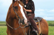 Lee McLean has been riding sidesaddle for over forty years. HerQuarter Horse, Cody, a retired community pasture horse, just recently made theswitch.